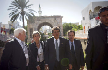 French State Minister for Foreign Trade Pierre Lellouche (center) led a delegation of French business leaders to Tripoli in October. European and Turkish companies have been active in pursuing contracts with the new Libyan government. Lionel Bonaventure/AFP/Getty Images